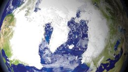 Globe of the earth, covered with snow