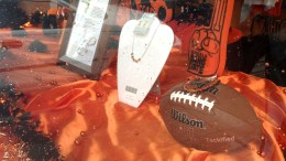 Window display at the Orange & Black Store showcases a variety of products.