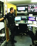 A public safety officer gives a tour of the command center.