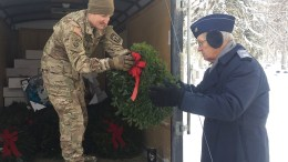 Cadet passing a wreath to soldier
