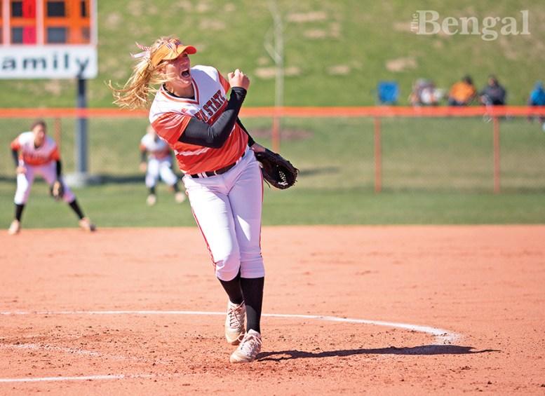 ISU Women's softball player at pitcher's mound