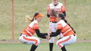 Haley Harrison (left), Kacie Burnett (center) and Aubrey Creekmore celebrate a home win against Portland State.