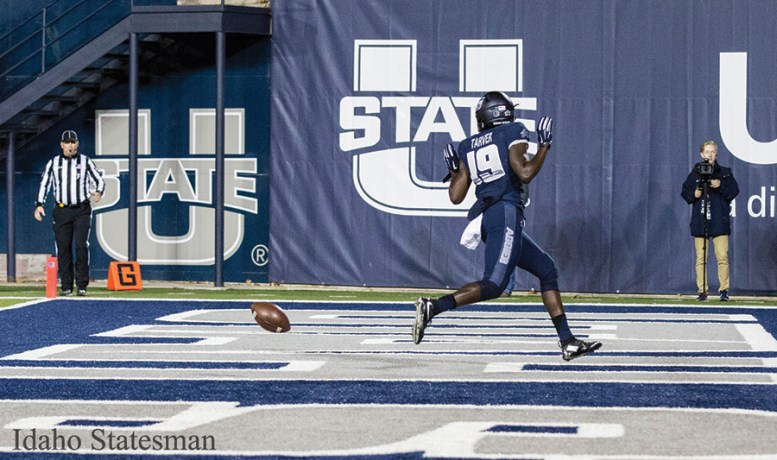 Utah State football player in the end zone