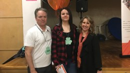 Megan Farish (center) from Independence High School receives her Road Scholarship with her principal Mark Kartcher (left) and Dean Turley-Ames (iight).
