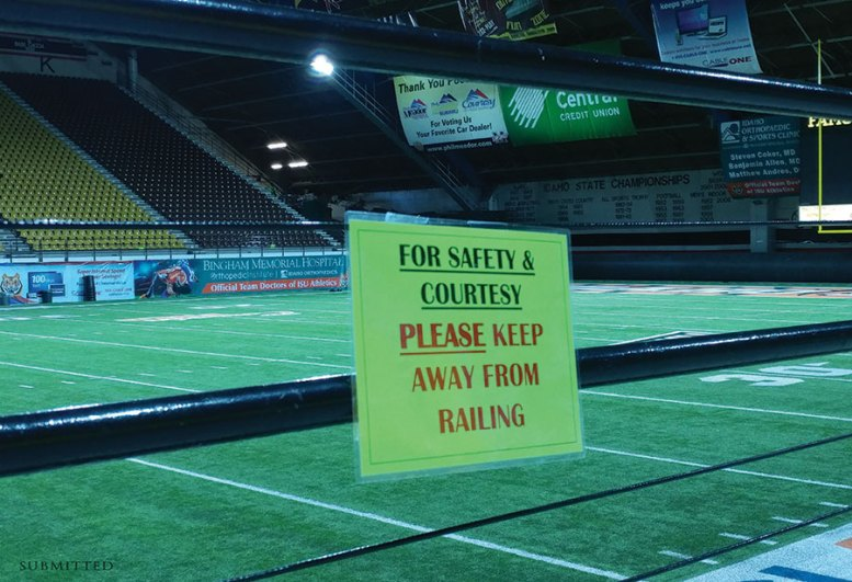 """Holt Arena sign """"For safety & courtesy please keep away from railing"""""""