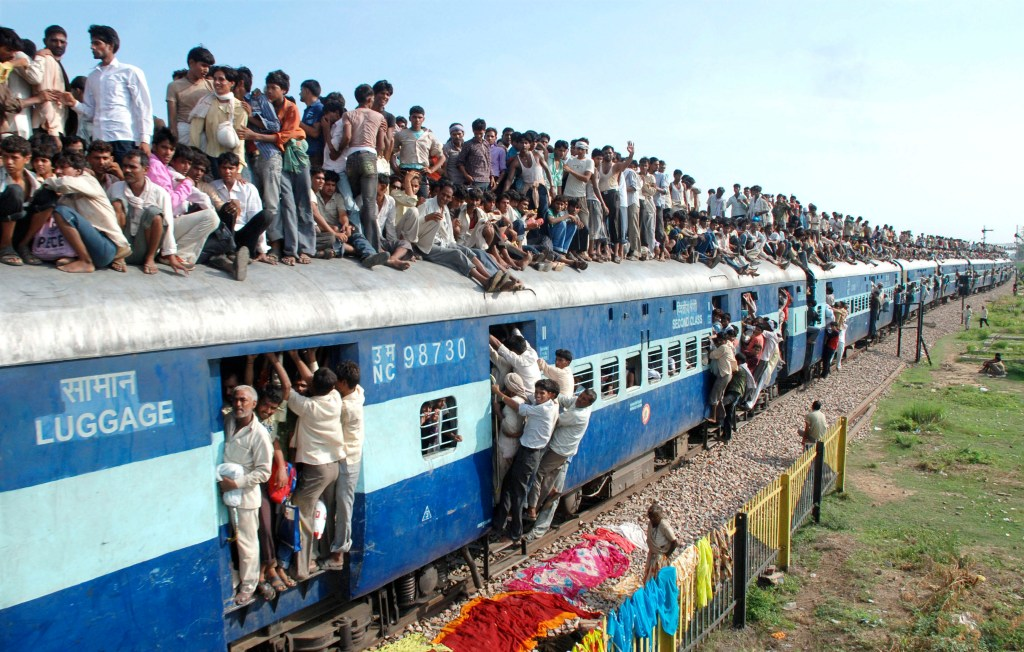 Hindu devotees travel on a crowded passenger train in Goverdhan