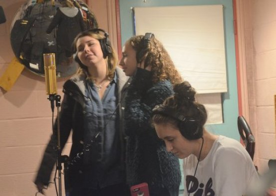 Sierra and Sarah practice backing vocals around the Lawson L-47 microphone