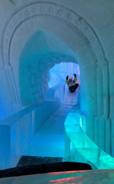 Robin on Slide in Hôtel de Glace :: A Night of Ice in Québec City :: I've Been Bit! A Travel Blog