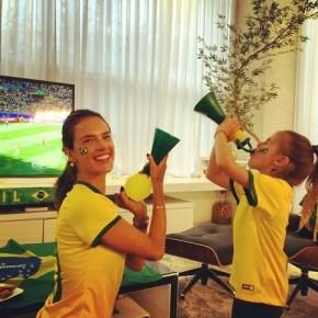 Alessandra and her daughter cheering on Brazil.