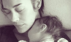 Megan Gale with River eyes closed napping