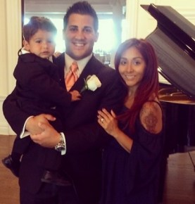 "Snooki with her ""two handsome boys"" partner Jionni and son Lorenzo"