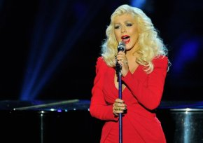 Christina Aguilera steps out for the first time since giving birth.