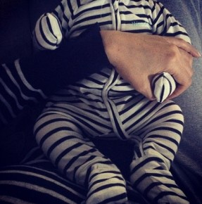 Megan Gale and her son River matching in stripes