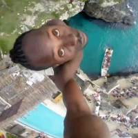Brave Jamaican man makes one of the most EXTREME dives you'll ever see! (Video)