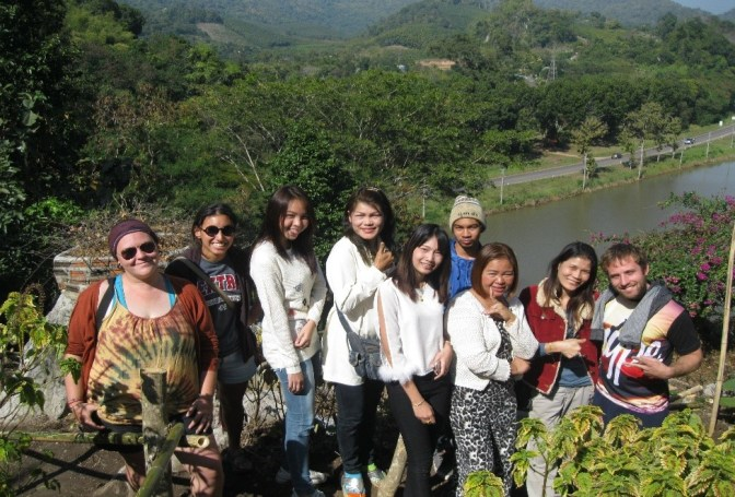 Krissy, Leah, and I posing with some friendly Thai people near a gorgeous Buddha Statue in the Esan countryside
