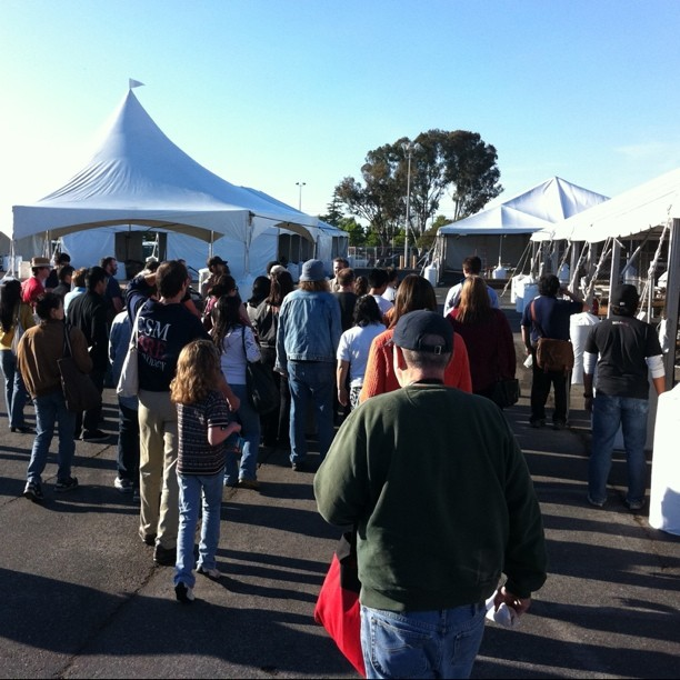 Make founder Dale Doughtery taking a large group of Maker Faire volunteers on a guided tour of the Maker Faire area. In the next 24 hours, this whole area will be transformed!
