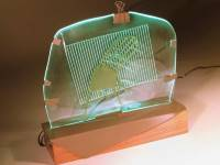 "Green Folded Chair, 20"" x 18"" x 10"", slumped glass, wood, fabricated mild steel, fiber optic neon, electronics"