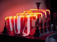 Tattered Glory, 23″ x 26″ x 19″, slumped glass, neon glass tubes, plastic laminate, cast concrete