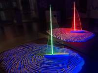 Desert Breeze, 8' x8' x 4', sand, luminous tubes powered by radio waves (no wires), sheet polycarbonate, wood