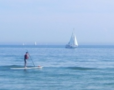 Paddleboard and sailboat as seen from Toronto's Island park.
