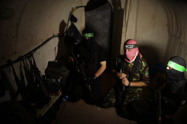 Hamas terrorists gather inside an underground tunnel in the Gaza Strip on Aug. 18, 2014. (Reuters/Mohammed Salem)