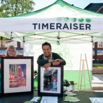 Nicole and Carmen from Timeraiser at the Lilac Festival.  They are showcasing art that will be available for auction June 16th at Flames Central.