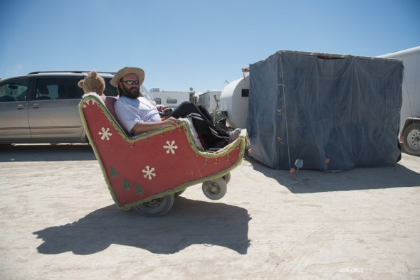 "The camp's mechanic, Chris on the ""Santa Chair"" a personal mutant vehicle loaned to us for the 2014 Burn, built on an electric wheelchair base."