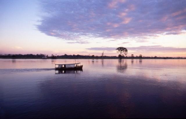 Small Boat on the Amazon near Autazes at Sunset