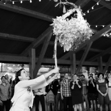 The bride hitting a Piñata at her wedding reception.