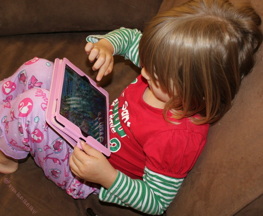 little girl playing game on ipad mini Looking For Fun Free Apps For Kids Without Advertisements?