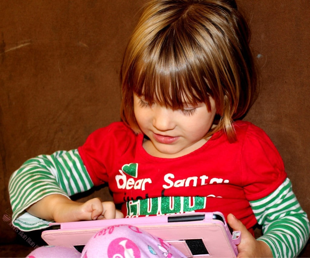Picture of toddler girl playing with iPad Looking For Fun Free Apps For Kids Without Advertisements?
