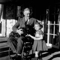 FDR with dog and Annie clone.