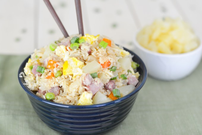 This Hawaiian Cauliflower Fried Rice is packed with so much flavor, including ham and pineapple-- the Hawaiian classics!-- that you won't even notice it's grain-free and full of veggies.