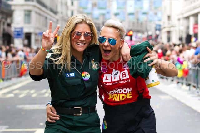 London firefighter and her ambulance worker girlfriend. Gay Pride, London 2015. © Jess Hurd/reportdigital.co.uk