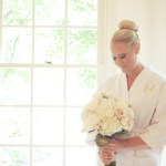 Bride in monogram robe with white hydrangeas - Image by: Meredith Rogers Photography | http://jessicadum.com/portfolio/hannah-terrence/