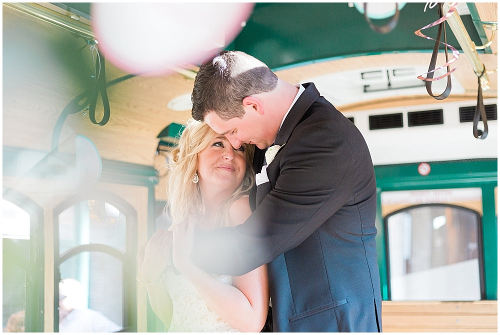 Bride and Groom on trolley | Downtown Indianapolis Wedding by Gabrielle Cheikh Photography & Jessica Dum Wedding Coordination