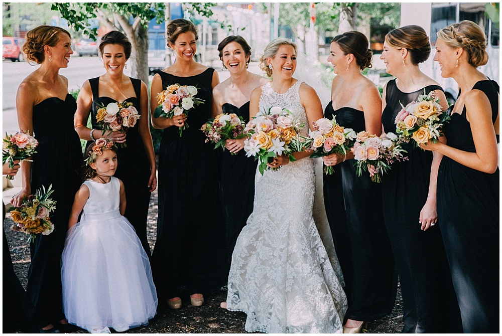 Lace wedding dress, black bridesmaids dresses and organic summer wedding bouquets | Downtown Indianapolis Wedding by Caroline Grace Photography & Jessica Dum Wedding Coordination