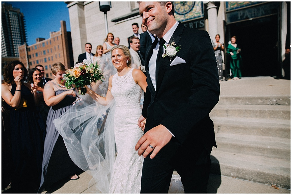 Bride and Groom ceremony exit, and lace wedding dress | Downtown Indianapolis Wedding by Caroline Grace Photography & Jessica Dum Wedding Coordination