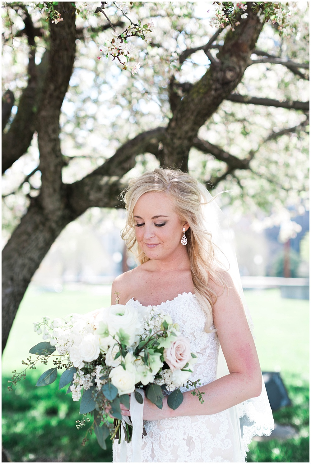 Lace strapless wedding gown with blush bridal bouquet | Downtown Indianapolis Wedding by Gabrielle Cheikh Photography & Jessica Dum Wedding Coordination