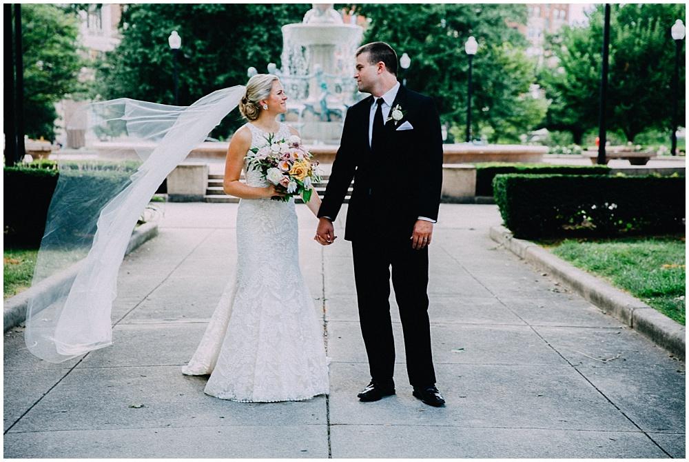 Lace wedding dress and organic summer wedding bouquet | Downtown Indianapolis Wedding by Caroline Grace Photography & Jessica Dum Wedding Coordination