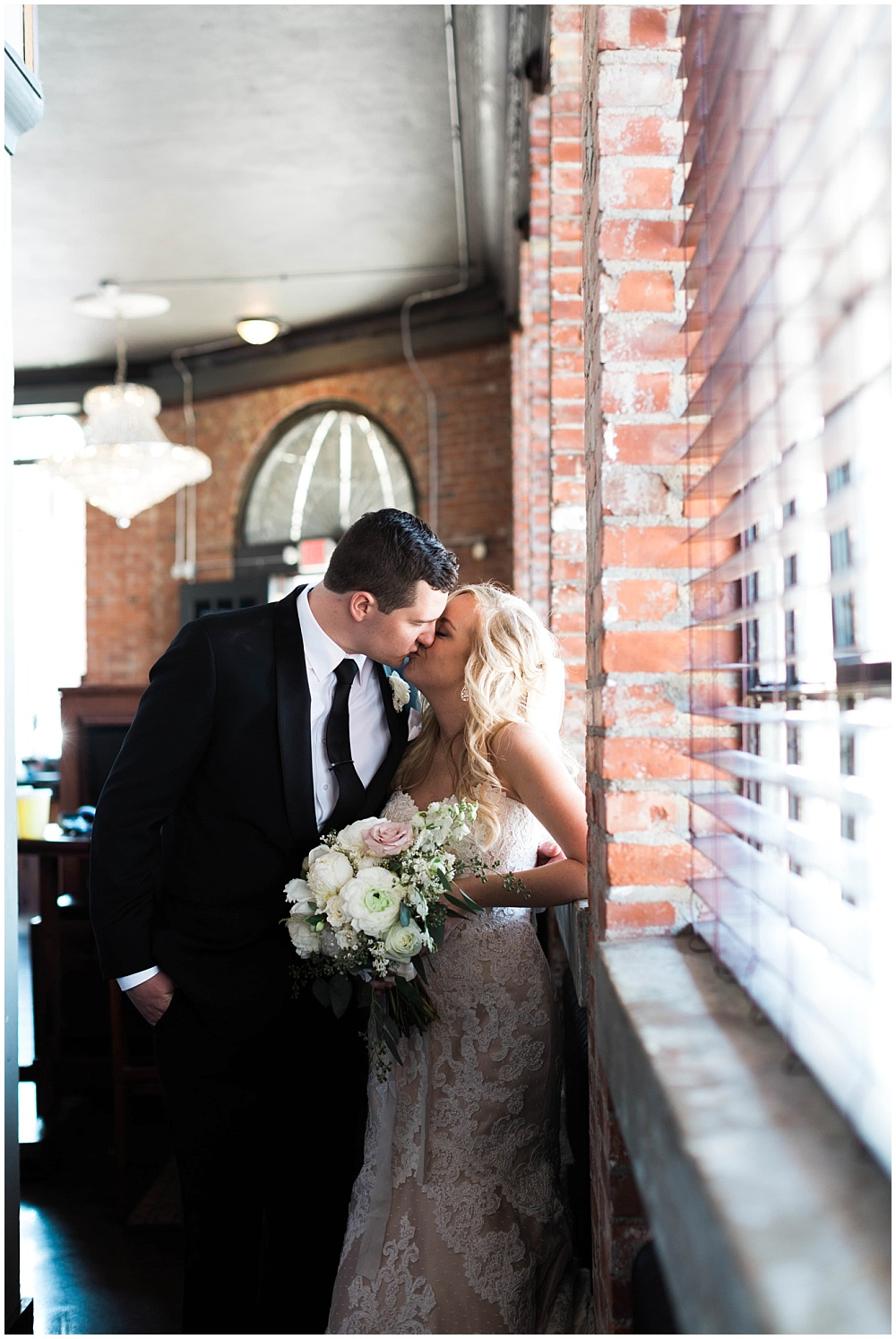 Bride and Groom Kissing | Downtown Indianapolis Wedding by Gabrielle Cheikh Photography & Jessica Dum Wedding Coordination