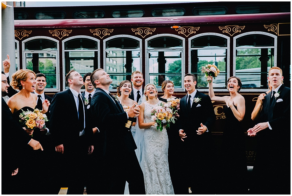 Bridal Party popping champagne | Downtown Indianapolis Wedding by Caroline Grace Photography & Jessica Dum Wedding Coordination