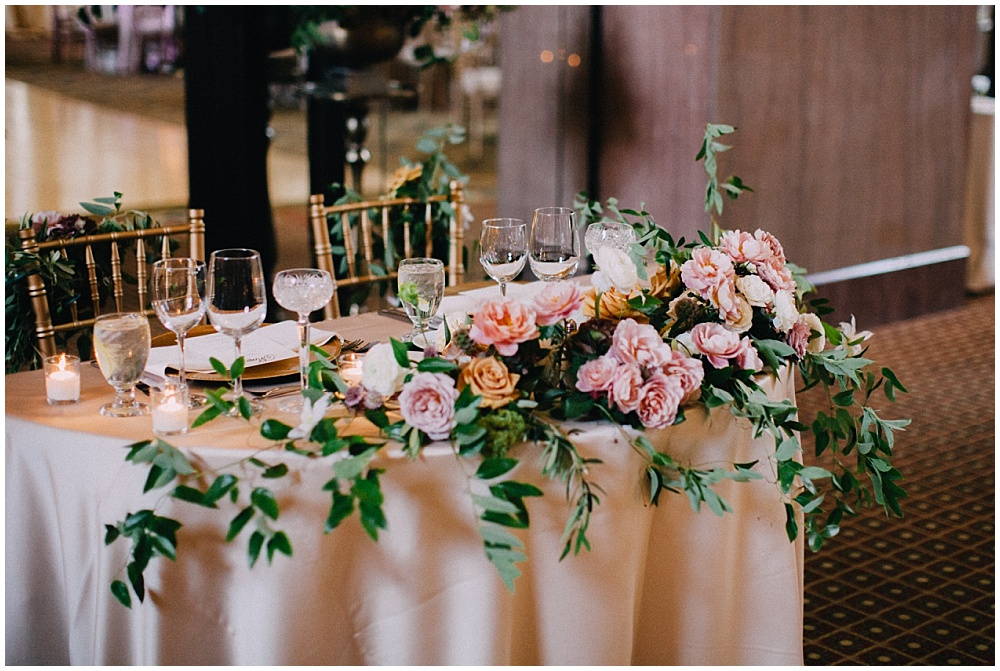 Sweetheart table with gorgeous summer wedding flowers | Downtown Indianapolis Wedding by Caroline Grace Photography & Jessica Dum Wedding Coordination