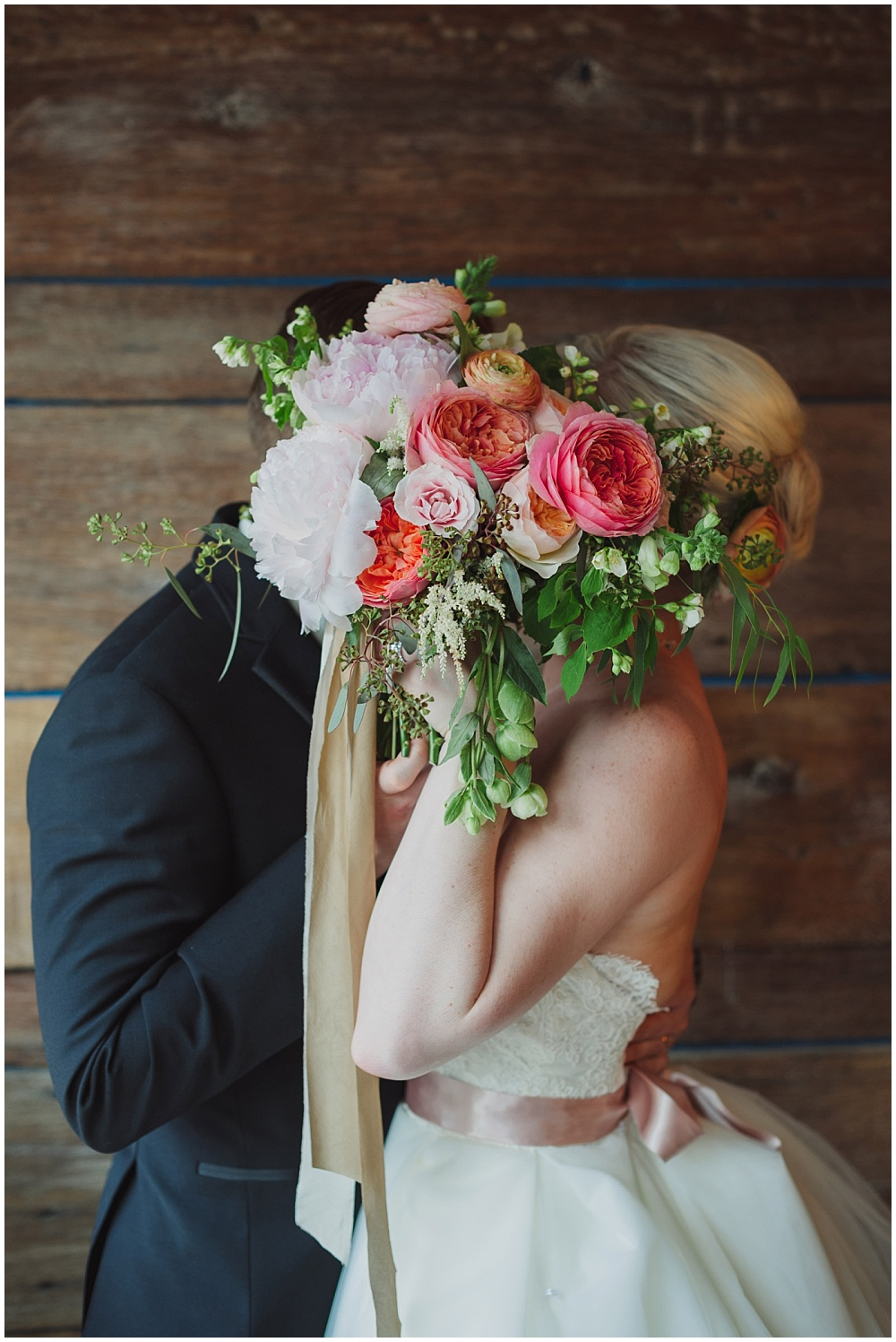 Bride and Groom with blush, pink and green bridal bouquet and silk ribbon | Ritz Charles Garden Pavilion Wedding by Stacy Able Photography & Jessica Dum Wedding Coordination