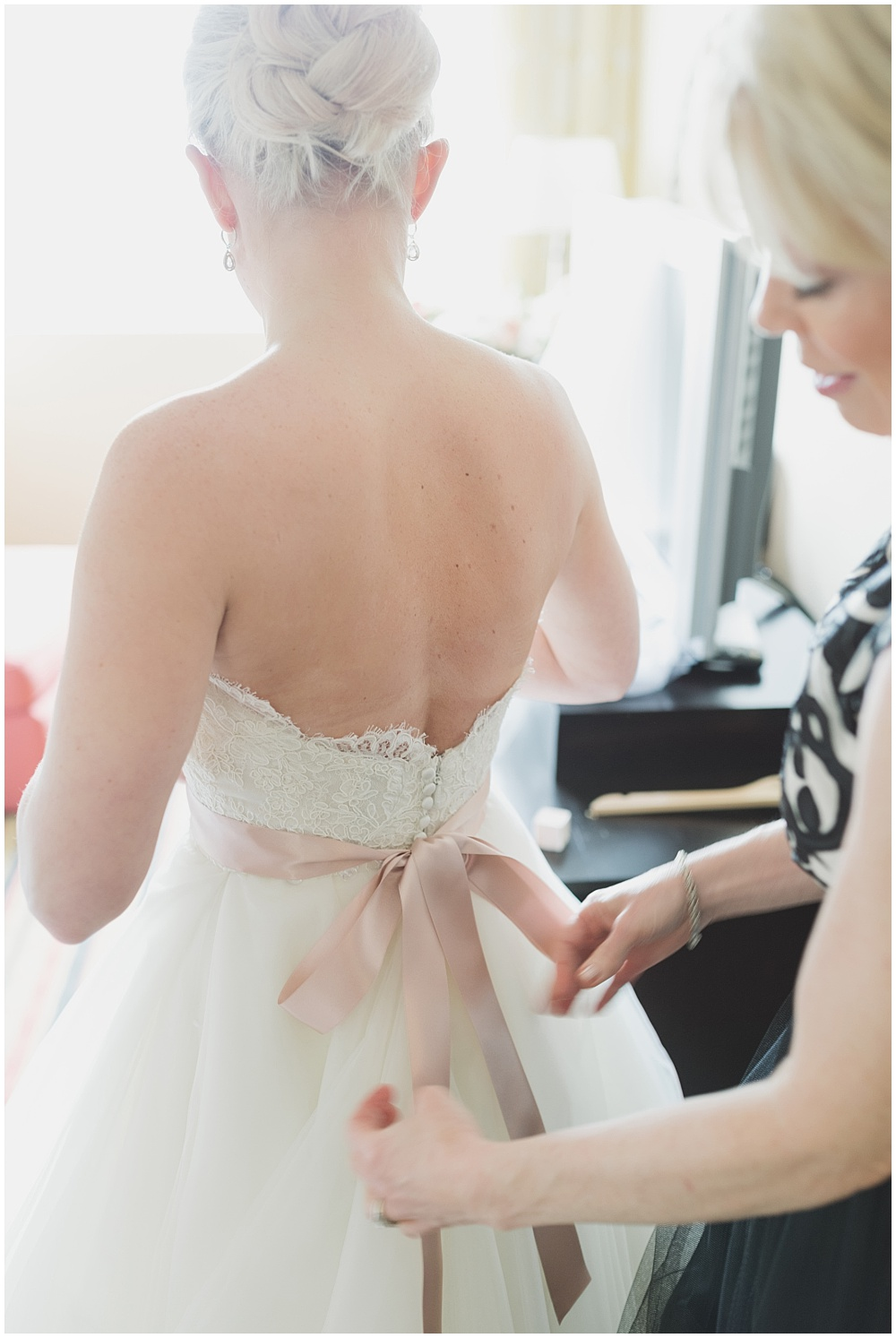 Back of Lazaro bridal gown with blush ribbon | Ritz Charles Garden Pavilion Wedding by Stacy Able Photography & Jessica Dum Wedding Coordination