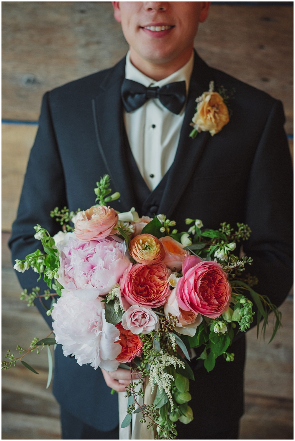Groom with blush spring bridal bouquet | Ritz Charles Garden Pavilion Wedding by Stacy Able Photography & Jessica Dum Wedding Coordination