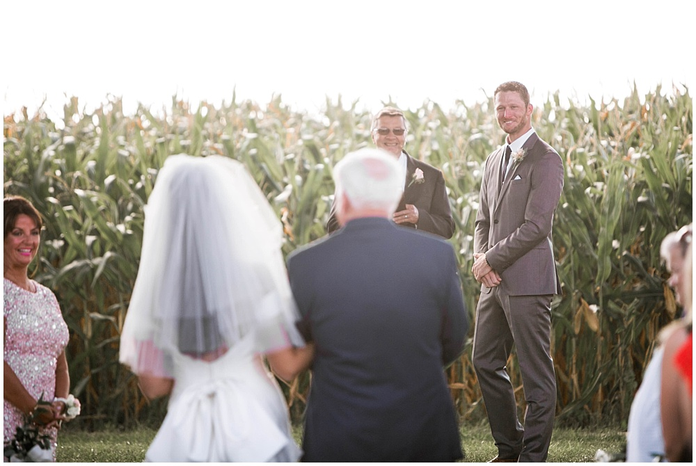 Groom's first look of his bride | Family Farm wedding by SB Childs Photography & Jessica Dum Wedding Coordination