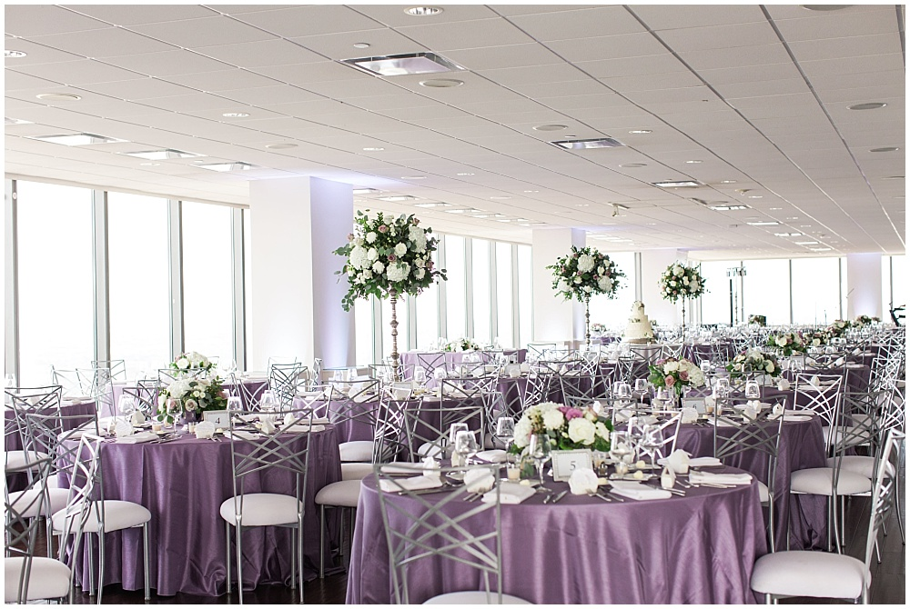 Purple and white wedding reception with skyline views | D'Amore Wedding by Ivan & Louise Images & Jessica Dum Wedding Coordination
