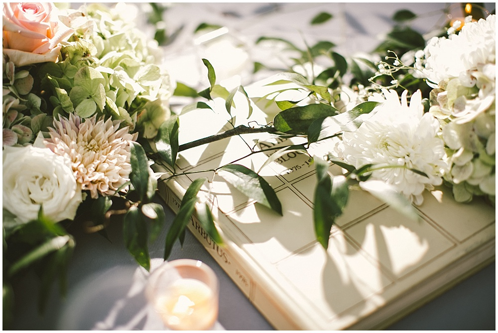 Library-themed centerpieces with books | Indianapolis Central Library Wedding by Jennifer Van Elk Photography & Jessica Dum Wedding Coordination