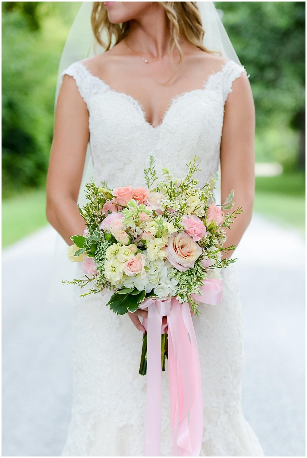 Lace wedding dress with blush, white and green bridal bouquet | Mustard Seed Gardens Wedding by Sara Ackermann Photography & Jessica Dum Wedding Coordination